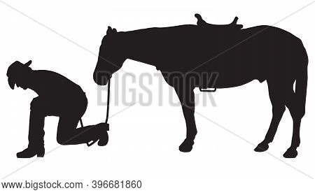 A Cowboy Tracker Is Kneeling And Studying The Ground