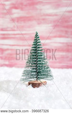 Christmas Toy Tree In Snowdrift. Beautiful Festive Background For Web, Print. Copy Space. Christmas