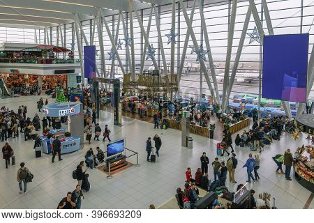 Budapest, Hungary - December 10 2019: International Airport Departure Area With Passengers. Unidenti