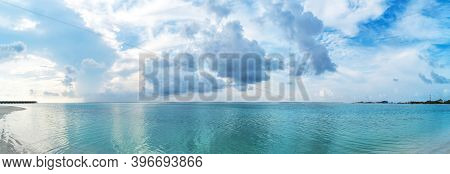 Only White Sand, Warm Azure Sea, Thick Cumulus Clouds On The Shore Of A Paradise Island. Maldives, T