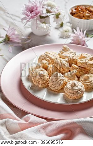 Swirled Meringue Cookies With Caramelized Walnuts Of Egg Whites Whipped With Sugar Served On A White