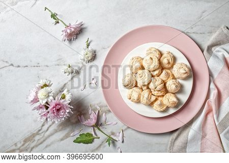 Swirled Meringue Cookies With Caramelized Walnuts Of Egg Whites Whipped With Sugar