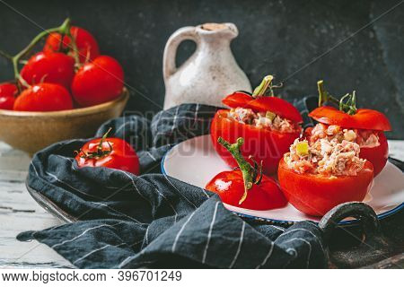 Traditional Portuguese Snack Tomatoes Stuffed With Canned Tuna Salad Over The White Table Cloth, Dec