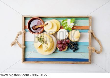 Traditional Portuguese Semi-soft Cheeses From Evora Alentejo And Azores Regions On The Tray, Served