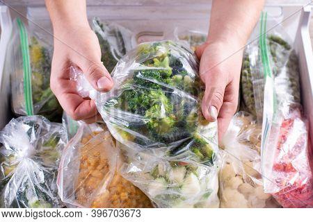Frozen Broccoli. Frozen Vegetables In A Plastic Bag In Freezer