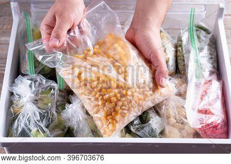 Frozen Corn. Frozen Vegetables In A Plastic Bag In Freezer