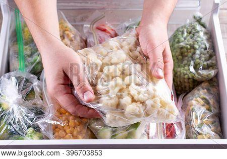 Frozen Cauliflower. Frozen Vegetables In A Plastic Bag In Freezer