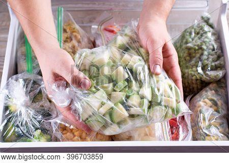 Frozen Zucchini. Frozen Vegetables In A Plastic Bag In Freezer