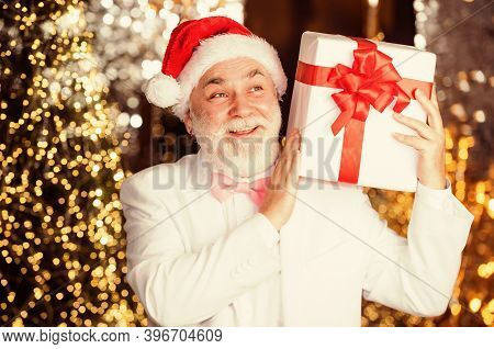 Great Gift. Cheap Xmas Present And Business Reward. Senior Man Santa Hat Hold Gift Box. Bearded Busi