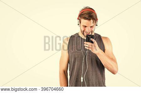 Audio Track. Man Handsome Unshaven Hipster Listening Audio File Using Headphones Gadget. Modern Earp