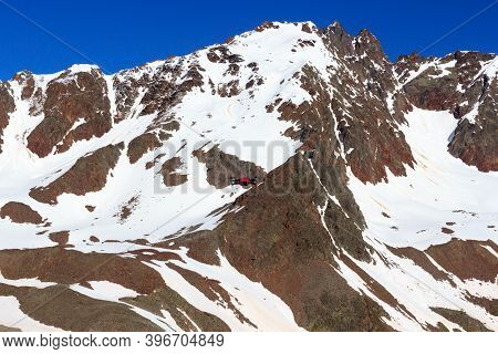 Drone Flying In Front Of Mountain Snow Panorama And Blue Sky In Tyrol Alps, Austria