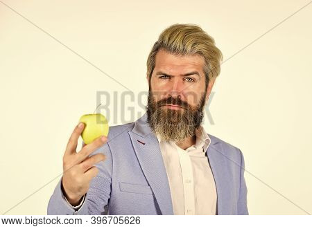 Vitamin And Diet. Fruit Harvest. Successful Businessman Holding An Apple. Business Lunch. Education