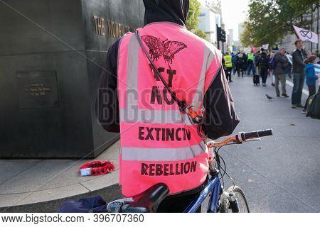 London, Uk - October 18, 2019: An Extinction Rebellion Activist Wearing An Xr Hi Vis Jacket At A Pro