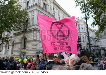 London, Uk - October 18, 2019: An Extinction Rebellion Flag Held Up In Front Of Downing Street At A
