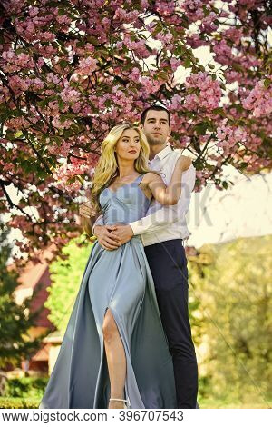 Loving People Hug. Passion Concept. Man And Woman In Blooming Garden. Couple Spend Time In Spring Tr