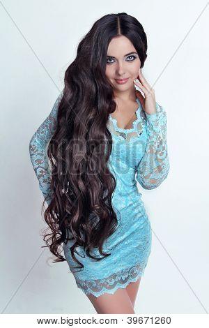 Beautiful Brunette Girl. Healthy Long Curly Hair. Lady In Blue Dress