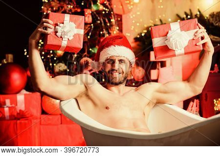 Power Of Present. Muscular Man Relax Bathtub. Sexy Mature Man Bath. Winter Holidays. Winter Decorati