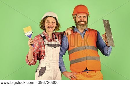 Couple Making Repairs To Their Home. Home Renovation. Couple Is Renovating Home. Couple Doing Apartm