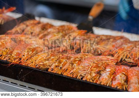 Close Up: Process Of Cooking Fresh Red Langoustine Shrimps, Prawns On Grill At Summer Local Food Mar
