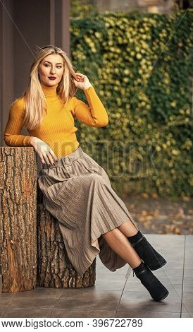 Trendy Girl Wear Corrugated Skirt. Pleated Skirt Collection. Woman Warm Autumn Skirt Sit Outdoor. Re