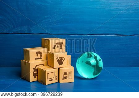 Glass Globe And A Bunch Of Boxes. Global Business And World Trade. Distribution Of Goods, Import And