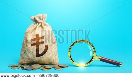 Turkish Lira Money Bag And Magnifying Glass. Revising The Budget To Save Money. Origin Of Capital Fu