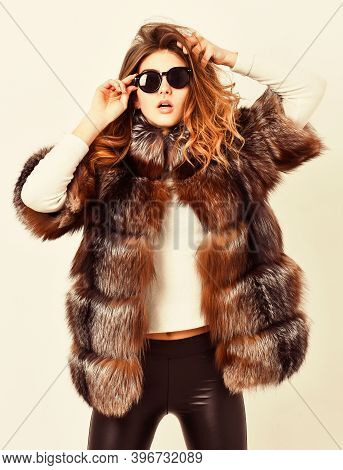 Fur Store Model Enjoy Warm In Soft Fluffy Coat With Collar. Woman Wear Sunglasses And Hairstyle Posi