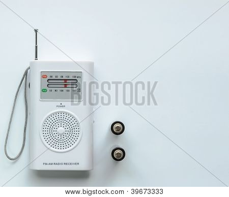 Small White Radio Receiver With Two Batteries