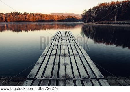 Frozen Mole (pier) In Winter Time With Crystal Blue Water And Hills On Background. Sunrise - Mole (j