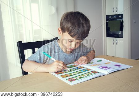 California, Usa - 19.04.2015 /portrait Of Cute Happy Kid Boy At Home Making Homework. Little Child L