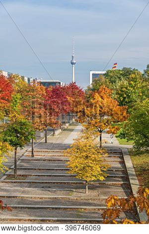 Berlin, Germany - October 20, 2020: Paul Loebe Allee Lined With Autumn Coloured Trees And The Televi