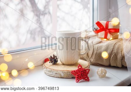 Hot Tea, Coffee. Winter Background With Cup Of Coffee, Tea, On The Window, Knitted Scarf And Gift. C