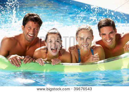 Group Of Friends Having Fun In Swimming Pool