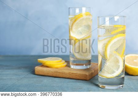 Soda Water With Lemon Slices On Blue Wooden Table. Space For Text