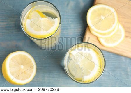 Soda Water With Lemon Slices On Blue Wooden Table, Flat Lay