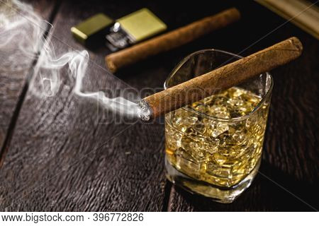 Smoking Cigar, Smoke Smoke. Glass Of Whiskey And Alcoholic Drink, Concept Of Rest Or Lifestyle