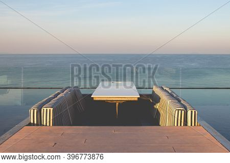 Tropical View Of Outdoor Rooftop Of Building With Seascape View In Background.