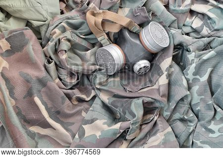Stalker Soldiers Soviet Gas Mask Lies On Many Green Khaki Camouflage Jackets