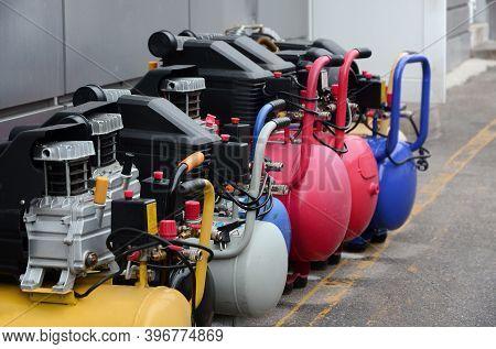 Many New Air Compressors Pressure Pumps Close Up