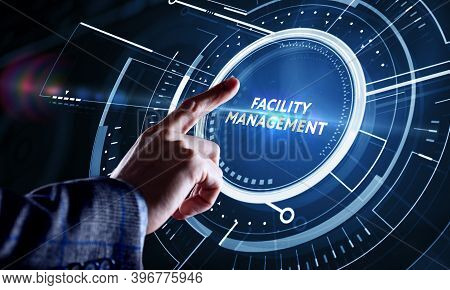Businessman Presses Button Facility Management On Virtual Screens. Business, Technology, Internet An