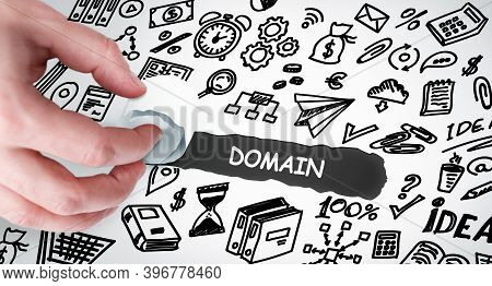 Technology, Internet And Network Concept. Young Businessman Shows The Word: Domain