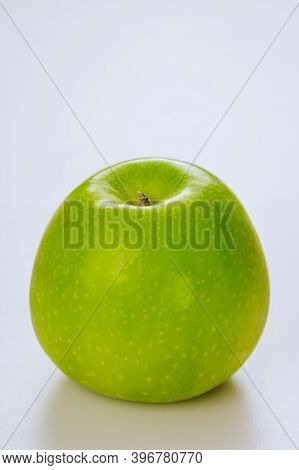 Whole Green Apple And Isolated On White Background. Produce Product. Close Up.