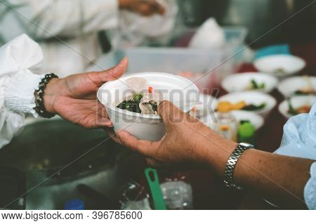 Free Food For Poor And Homeless: Concept Serving Free Food To The Poor