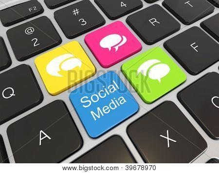 Social media on laptop keyboard. Conceptual image. 3d
