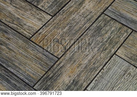 Detail Of Floor Tiles With Embossed Wood Texture. Brown Flooring Close-up.