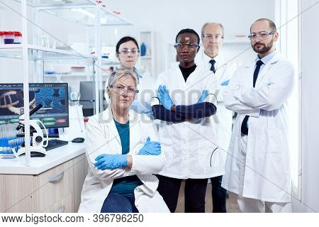 Healthcare Researcher At Workplace Standing Together With Arms Crossed. African Healthcare Scientist