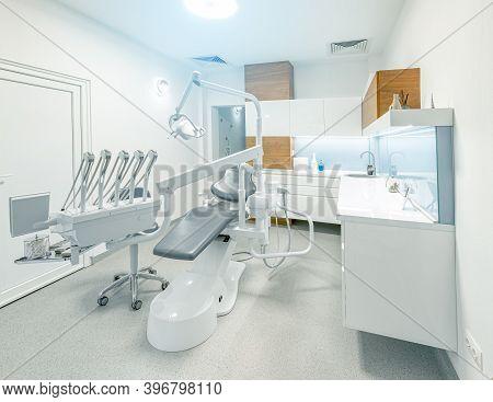 Stomatology Instruments On Stomatology Cabinet Background. Oral Health Concept.