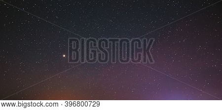 Night Starry Sky With Glowing Stars. Bright Glow Of Planet Venus In Sky Among Stars. Sky In Lights O