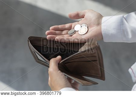 Young Man Opened A Purse With Only Coins, Economic Downturn, State Of Lack Of Money And No Governmen