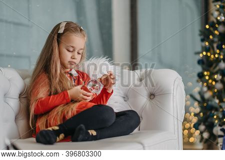 Single Girl Holding Christmas Toy, Lack Of Love And Attention From Parents, Feeling Lonely And Negle